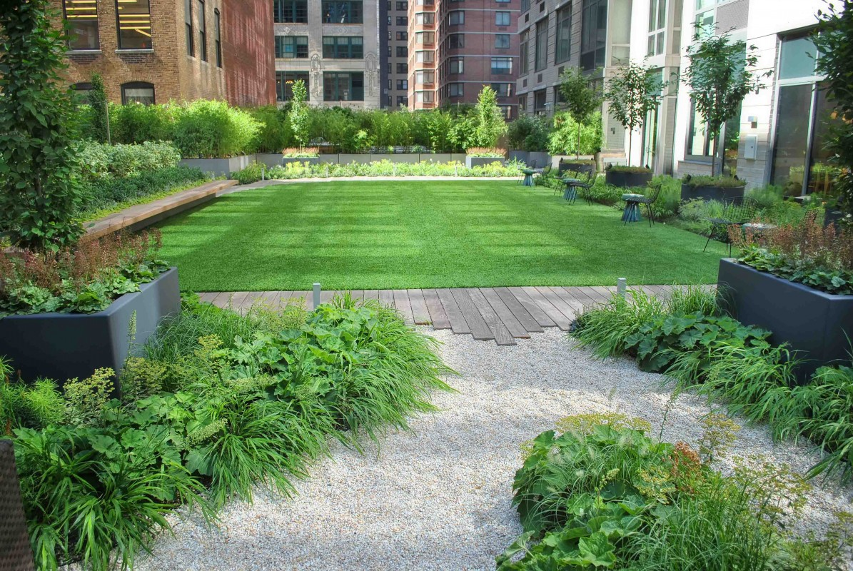 By re-using the existing pavers as the underlayment for the new synthetic lawn, we were able to execute the design intent seamlessly with the existing conditions.