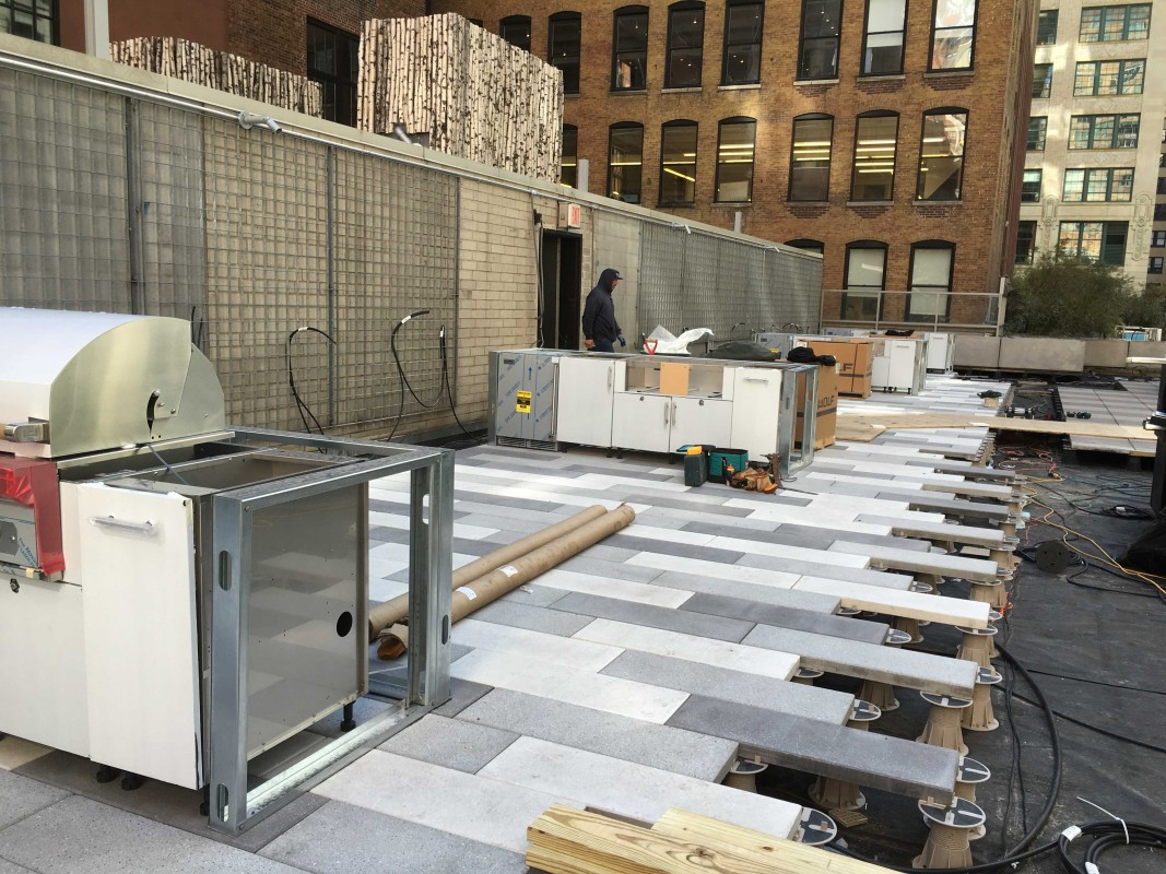 After demolition, our team started installing the paving system and new BBQ stations.