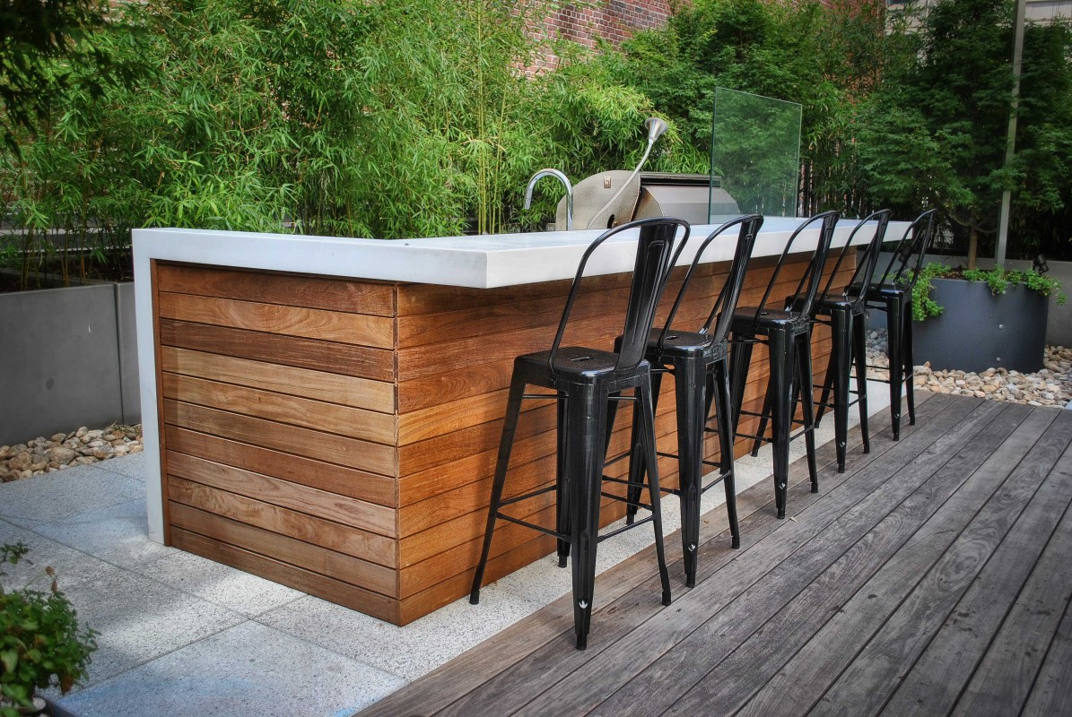 "The ""private terrace"" featured a larger BBQ counter complete with an outdoor sink, along with corian countertops."